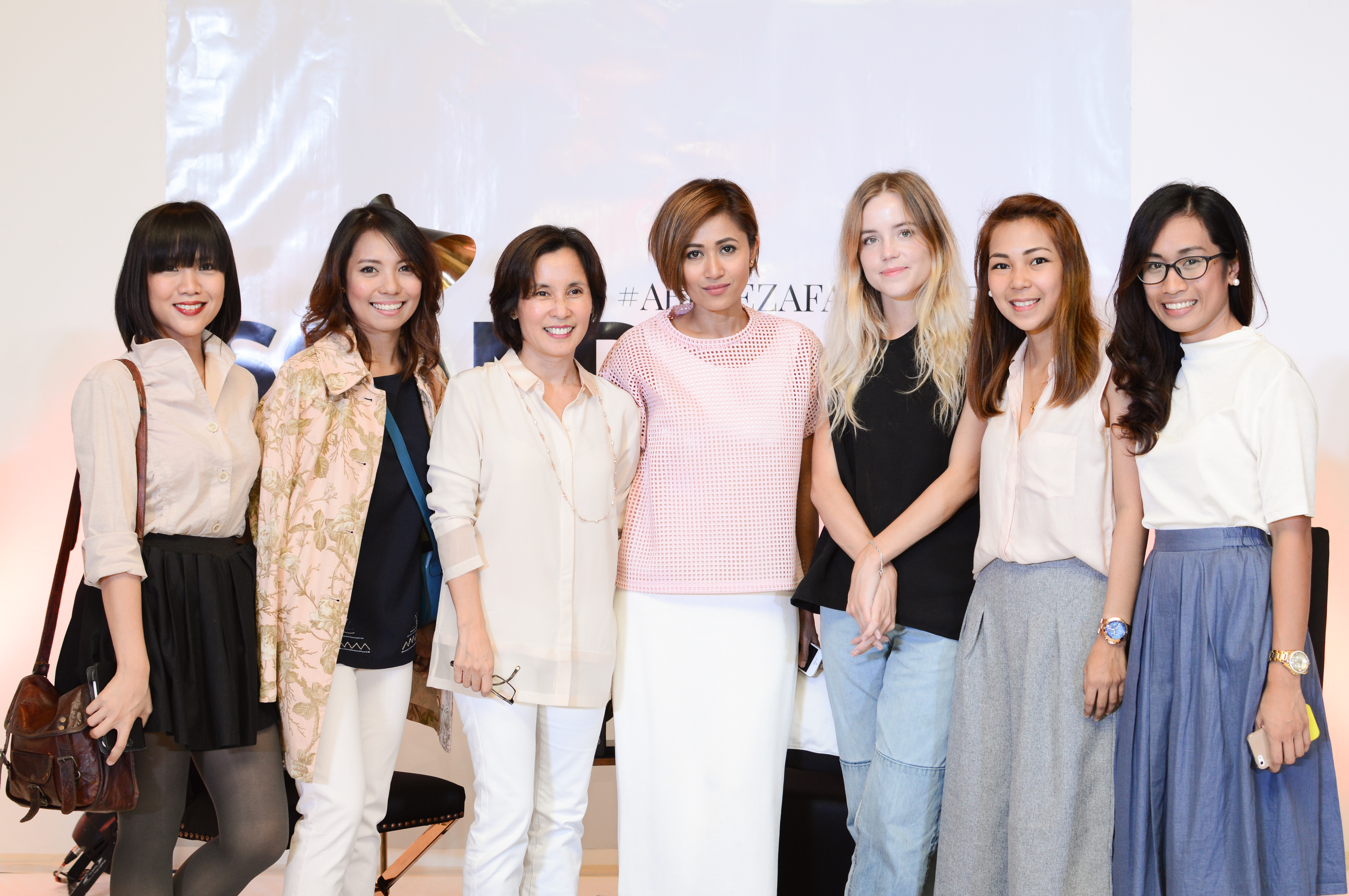 Pam Quiñones and Philippa Andrén with the Abreeza Mall marketing team